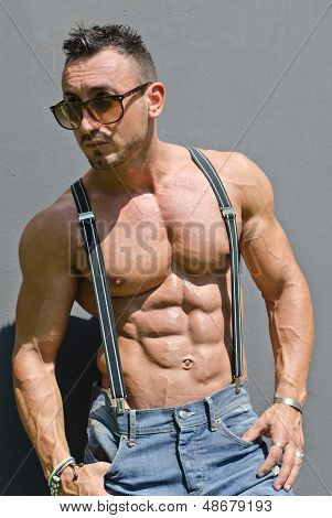 Handsome, Muscular Bodybuilder With Suspenders Shirtless