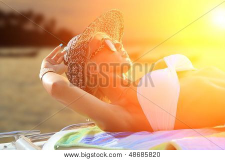 Hot fit woman on her yacht at sunset in Thailand