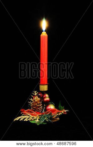 Red Christmas candle against black.