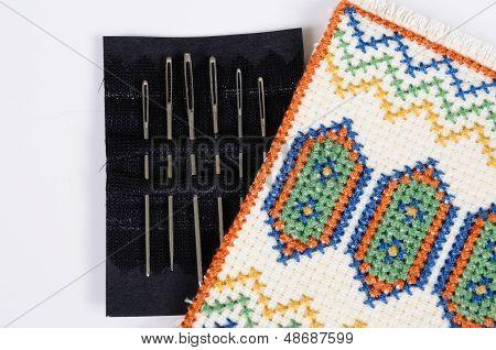 Tapestry needles in holder.