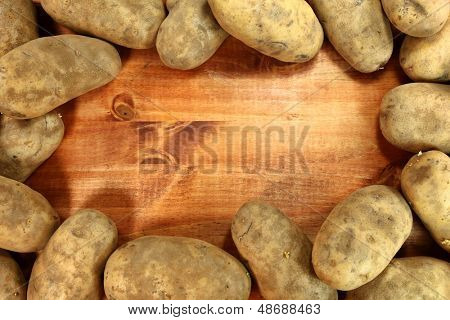 Framed Image of Russet Potatoes on a Wooden Background