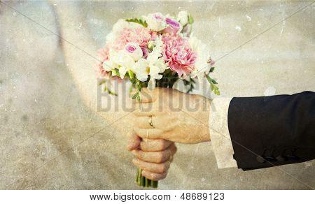 Groom handing over wedding bouquet - vintage photo