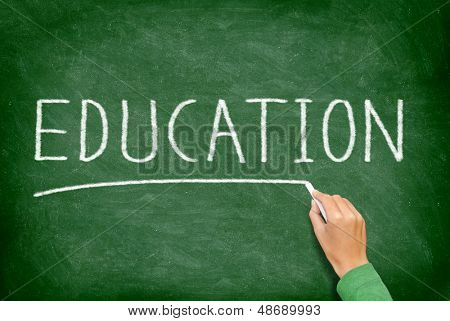Education. School, teaching and educational concept blackboard. Hand writing EDUCATION on green chalkboard. Primary school, secondary school, high school or college university.