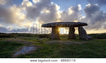 A Starburst Of Sun Gleaming Through Tlanyon Quoit An Ancient Neolithic Dolmen In Cornwall
