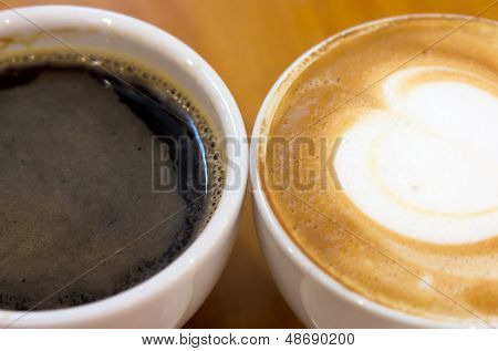 Black Coffee And Cappucino In The Cup