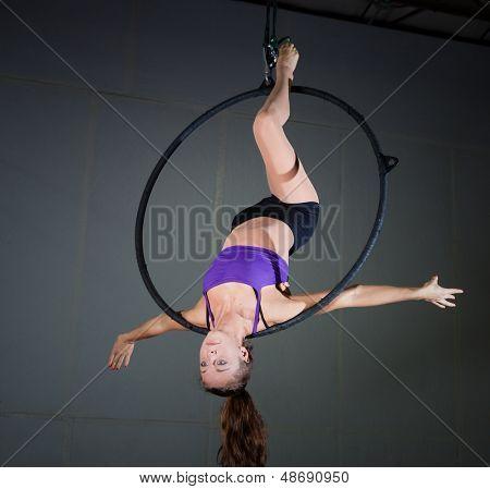 Woman gymnast performing aerial exercises