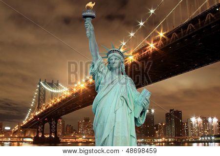 manhattan Bridge and The Statue of Liberty at Night, New York City