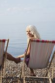 stock photo of herne bay beach  - Portrait of beautiful woman holding man - JPG