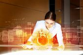 stock photo of cardiology  - Image of attractive woman cardiologist examining virtual heart - JPG