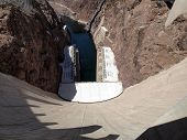 foto of breath taking  - Breath taking view of the Colorado River Hoover Dam wall looking downwards to generators below on the border of Arizona and Nevada USA - JPG