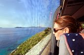 Woman In The Bus Looks Out Of The Window On A Sea Landscape
