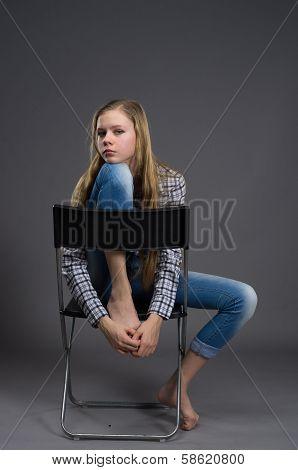 nice girl in jeans posing in studio
