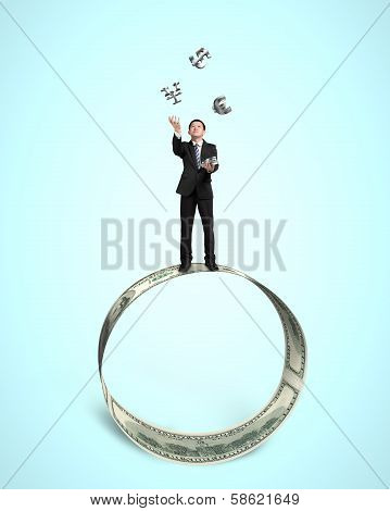 Businessman Throwing And Catching 3D Money Symbols On Money Circle