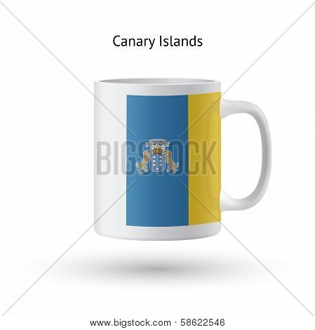 Canary Islands flag souvenir mug on white background.