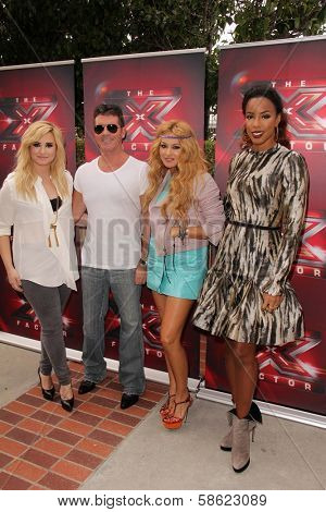 Demi Lovato, Simon Cowell, Paulina Rubio and Kelly Rowland at