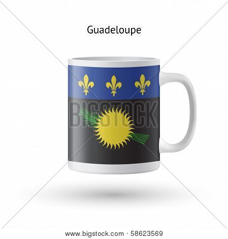 Guadeloupe flag souvenir mug on white background.