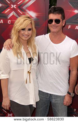 Demi Lovato and Simon Cowell at