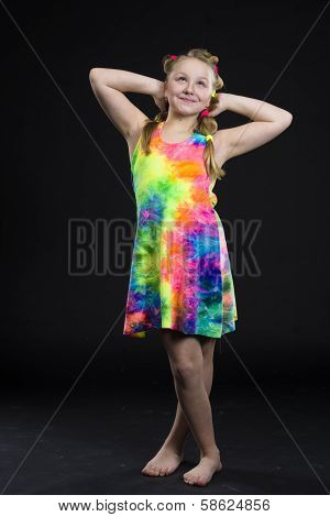 Child girl posing in colourful dress