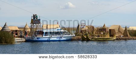 Lake Titicaca Tourist Boat And Totora Boat At Reed Island
