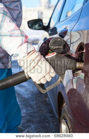 Female Hand Fills The Car With Gasoline 92