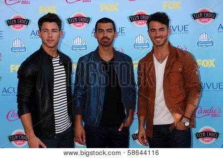 Nick Jonas, Joe Jonas and Kevin Jonas at the 2013 Teen Choice Awards Arrivals, Gibson Amphitheatre, Universal City, CA 08-11-13