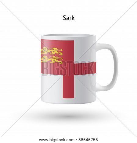 Sark flag souvenir mug on white background.