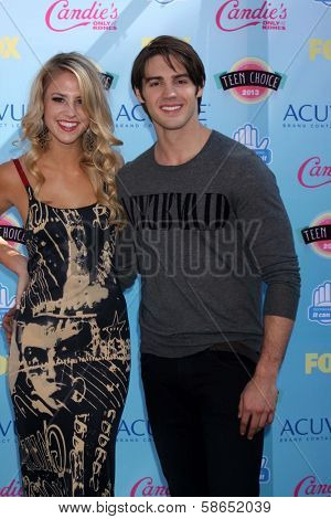 Steven R. McQueen and guest at the 2013 Teen Choice Awards Arrivals, Gibson Amphitheatre, Universal City, CA 08-11-13