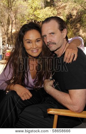 Tia Carrere, Michael Biehn on the set of