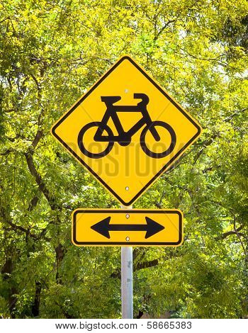 Bicycle Path Sign Against A Background Of Sunlit Leaves