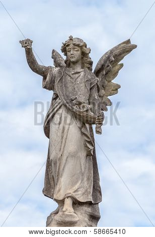 Stone Angel Statue Against Clouds And Blue Sky