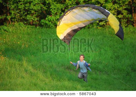 boy and parachute near the ground