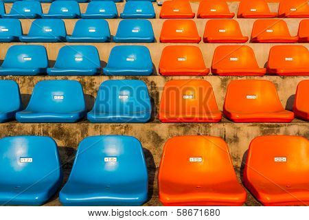 The Empty Blue And Orange Stadium Seat.