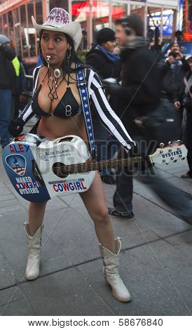 Alex, the Naked Cowgirl, entertains the crowd in Times Square during Super Bowl XLVIII week
