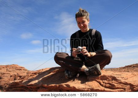 Backpacker Looking At Digital Camera