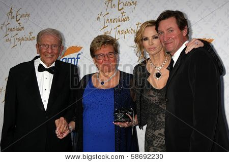 Alfred Mann, Rika Mann, Janet Jones Gretzky and Wayne Gretzky at the 10th Alfred Mann Foundation Gala, Robinson-May Lot, Beverly Hills, CA 10-13-13