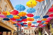 stock photo of serbia  - Many open in the sky umbrellas give a guarantee that the rain will not spoil the day Belgrade Serbia - JPG