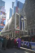 Visitors waiting in line to enter Vince Lombardi Trophy Pavilion on Broadway at Super Bowl XLVIII