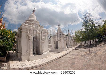 Row Of White Pagodas In Maha Lokamarazein Kuthodaw Pagoda In  Myanmar.