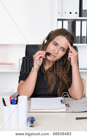 Young Exhausted Woman With Headset