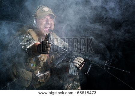 A soldier in the smoke after the explosion