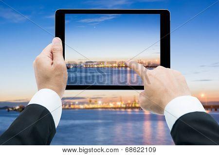 Businessman Hands Tablet Taking Pictures Commercial Docks At Sunset