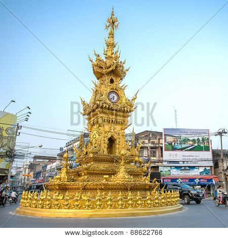 CHIANG RAI - JANUARY 10, 2014 : Street around golden clock tower, established in 2008 by Thai visual artist Chalermchai Kositpipatat, at night on January 10, 2014 in Chiang Rai, Thailand.