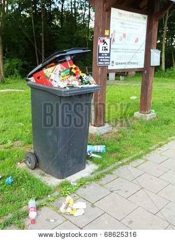 OFFENBERG, GERMANY - JULY 14 2014: Garbage and dirt on a pull off highway.  Routine situation every summer holidays. Waste management in European Union.
