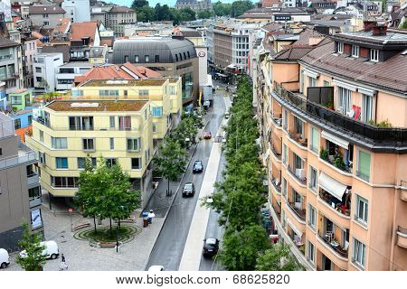 LAUSANNE, SWITZERLAND - JULY 7, 2014: City street, Lausanne, Switzerland. The high angle view shows the roof tops and street of a typical Swiss city.