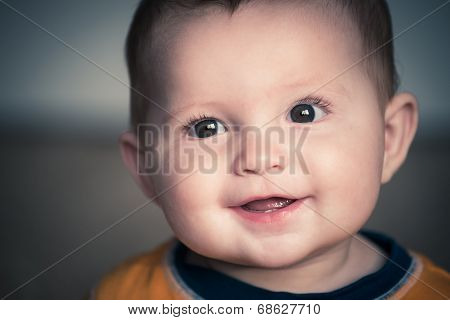 Close Up Portrait Of Cute Happy Baby Smiling In Vintage Filtered Image
