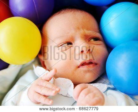 Newborn baby several days old enjoying new life
