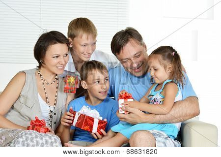 Friendly family with gifts