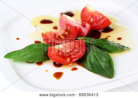 Balsamic vinegar,  tomato and basil isolated on white