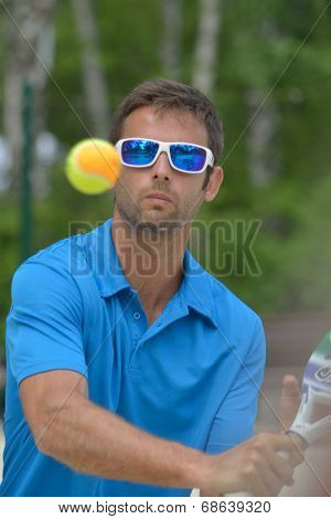 MOSCOW, RUSSIA - JULY 17, 2014: Raphael Jannel of France in the match with Greece during ITF Beach Tennis World Team Championship. France won in two sets