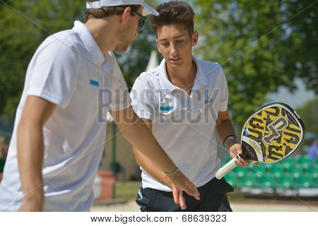 MOSCOW, RUSSIA - JULY 17, 2014: Men team San Marino in the match with Bulgaria during ITF Beach Tennis World Team Championship. San Marino won in two sets